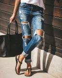 woman ripped fashion trendy stretch slim denim casual pencil pants
