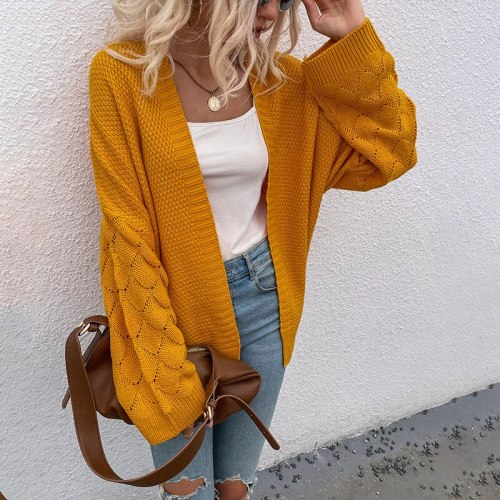 2021 autumn and winter new European and American V-neck cardigan solid color mid-length hollow sweater women