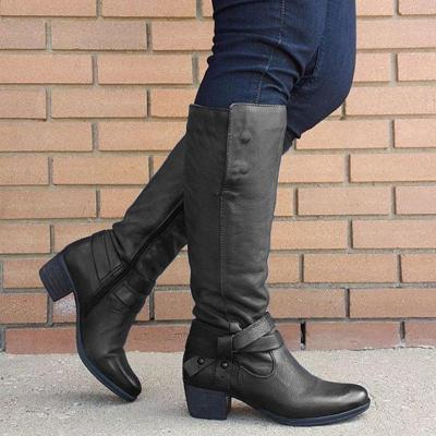 Woman with buckle zipper boots