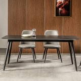 The Wenders Furniture Factory sand-marble dining table features a black iron center base that holds a generous slab of ornate marble Rock Board