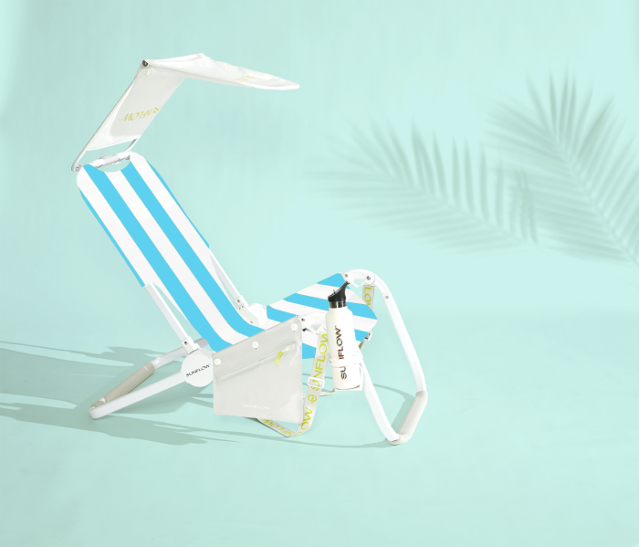 The SUNFLOW Beach Bundle setup includes a chair, shade, drink holder, dry bag, and towel