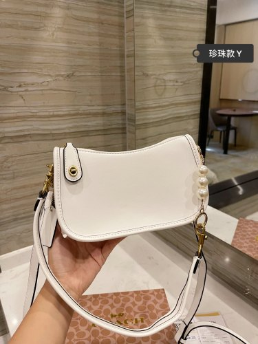 Coach Swinger Pearl underarm bag from Coach Store