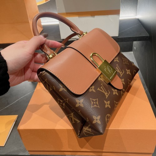 LOCKY BB This small and stylish Locky BB handbag is made of Monogram canvas and cowhide