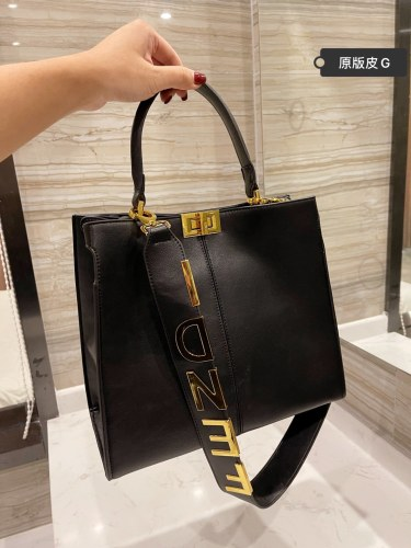 FENDI bag, smooth texture, bright line cut and embellished.