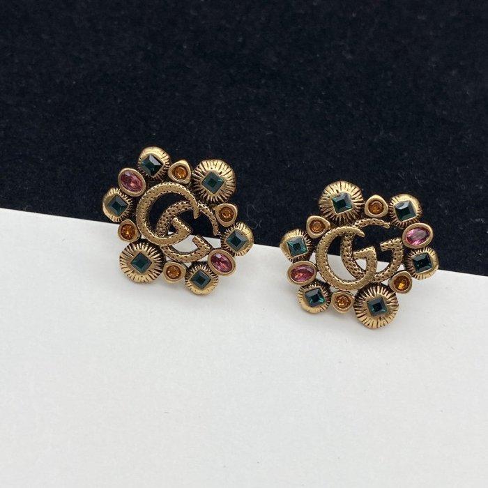 Vintage colored diamond earrings