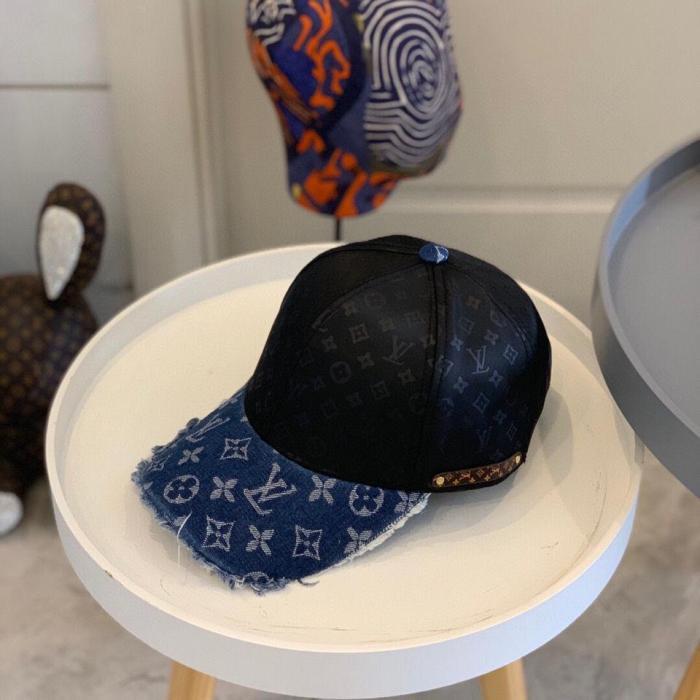 Distressed denim tassel baseball cap