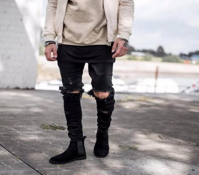 Black rip knee pants jeans
